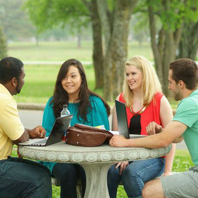 Students sitting around park table