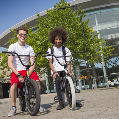 Two young men on bicycles in Milton Keynes city centre